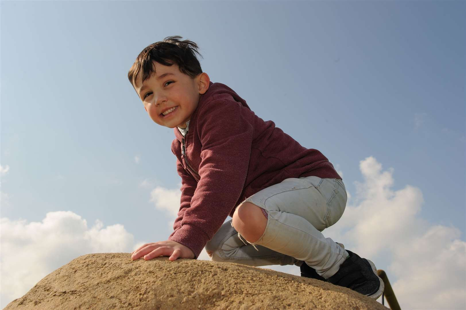 Jack, age four, on top of one of the big boulders for climbing