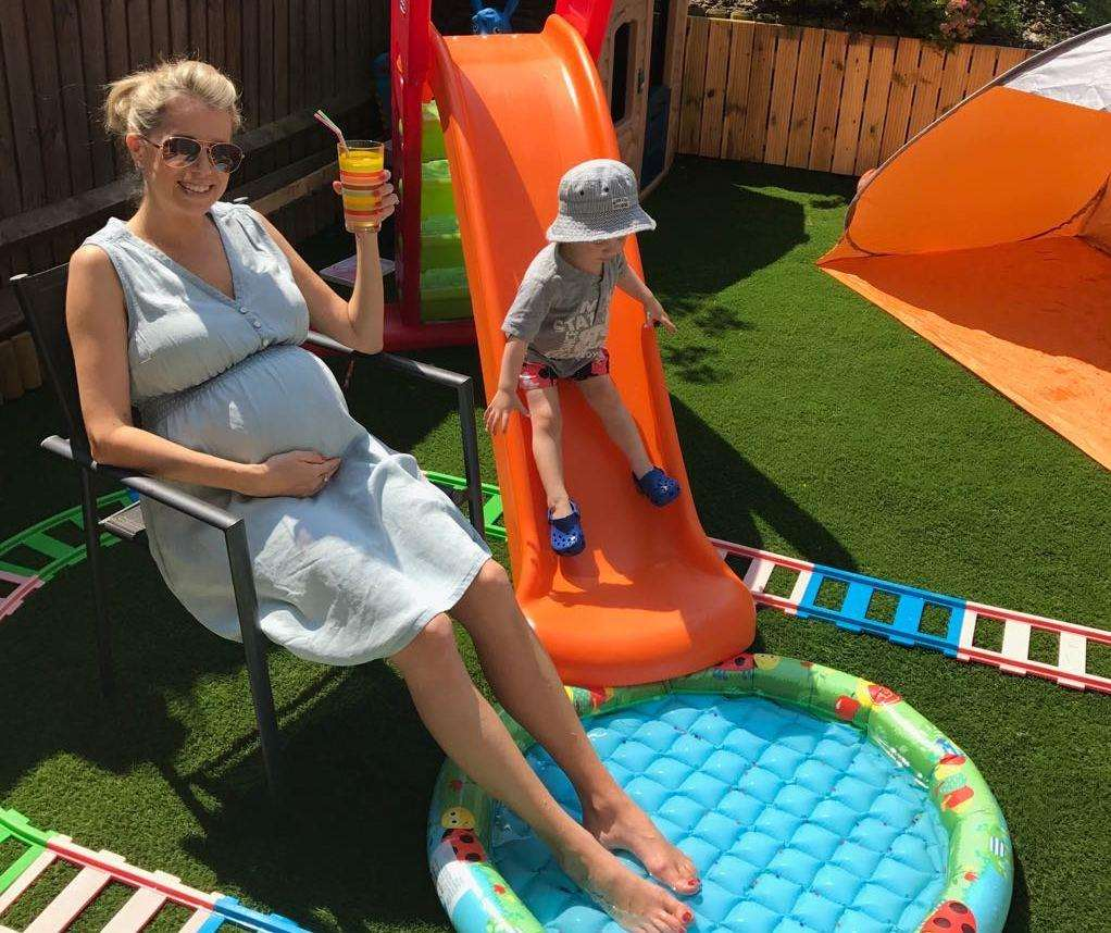 Cheers: With my £3 paddling pool last summer while pregnant