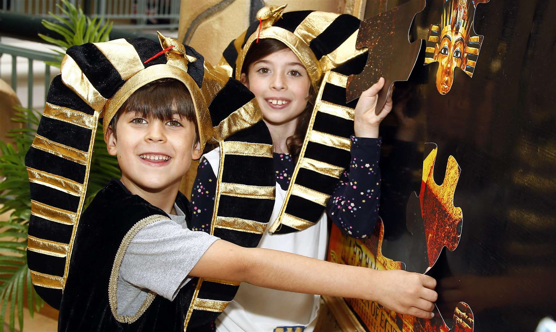 Royal Victoria Place, Tunbridge Wells, Walk Like an Egyptian summer exibition.Young Pharaohs for the day solving an Eqyptian puzzle Milly 8 and Frankie Amorese 7.Picture: Sean Aidan (3346281)