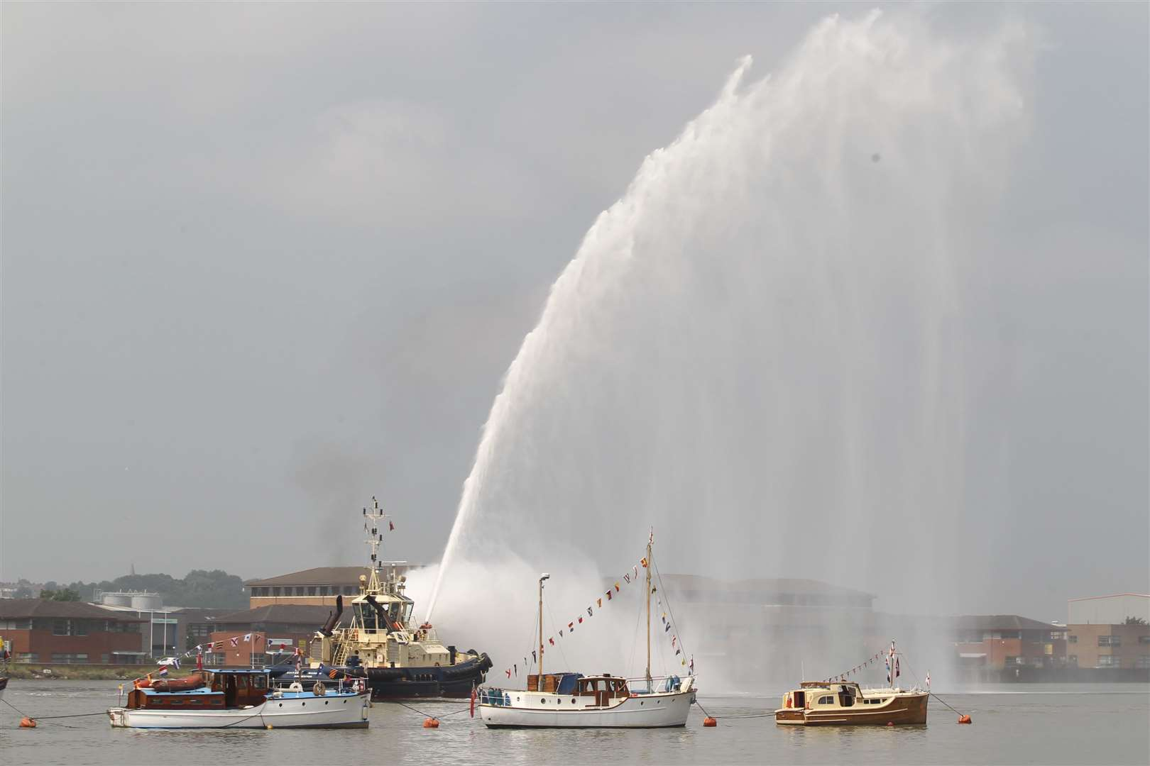 A fire boat shoots water in the air at The Medway River Festival