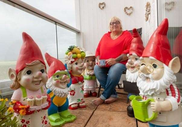 Janet Wilson on her balcony with some of her collection