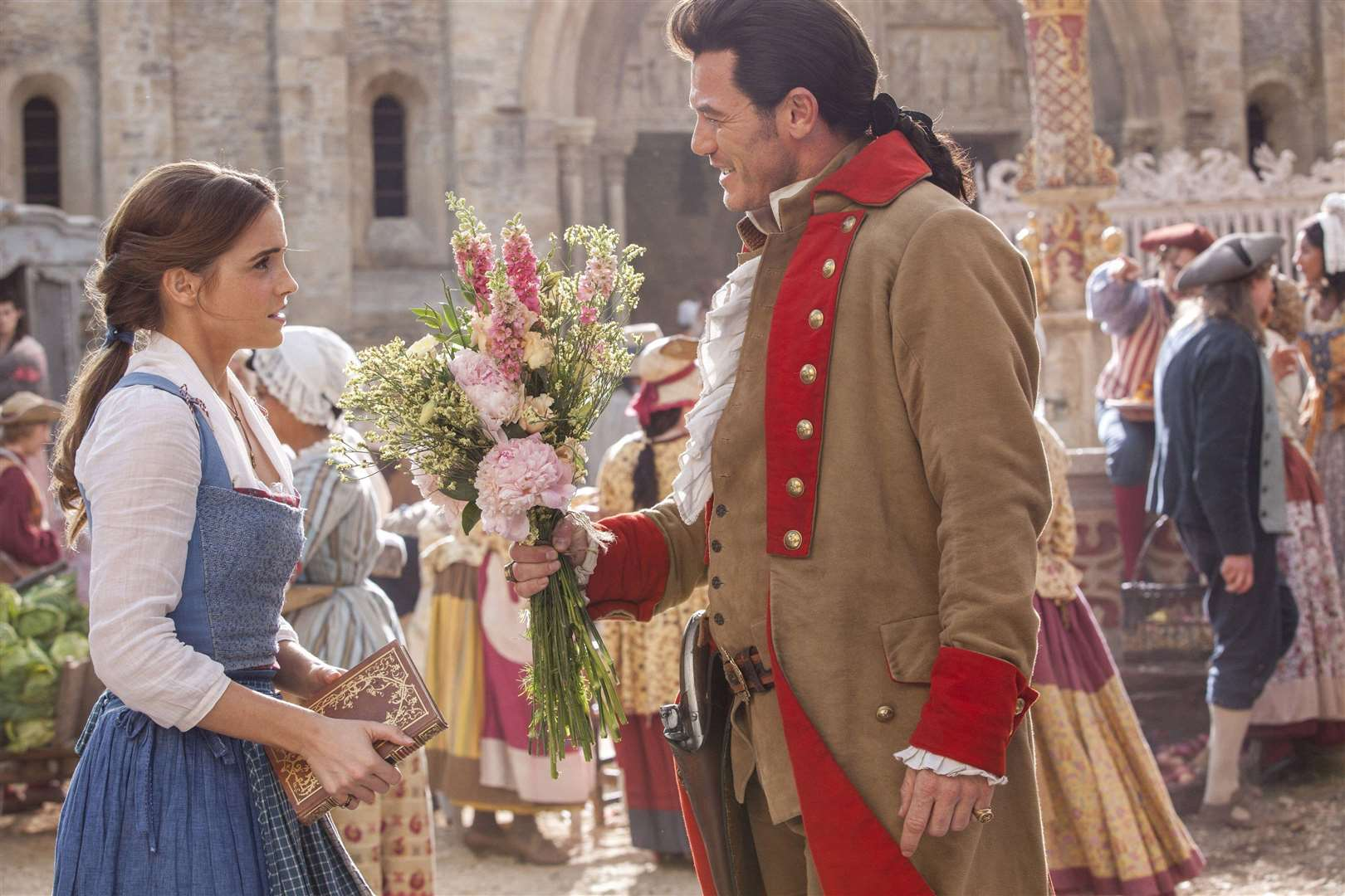 Emma Watson as Belle and Luke Evans as Gaston in Beauty And The Beast. Photo: PA Photo/Disney.