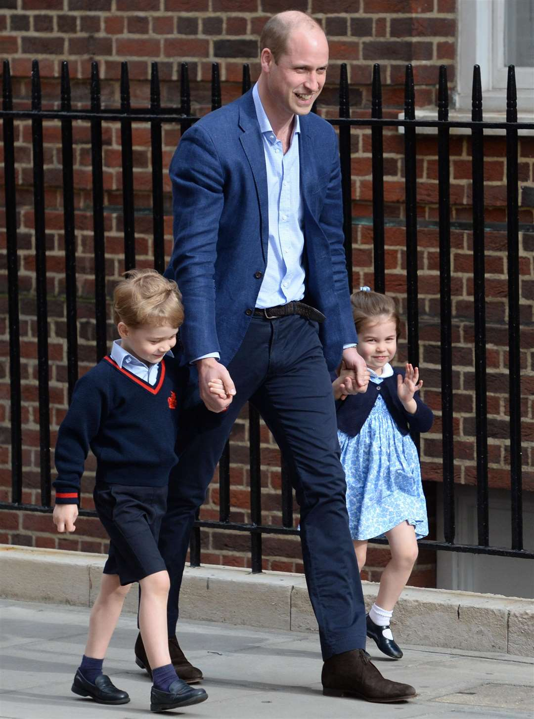 The Duke of Cambridge with Prince George and Princess Charlotte arriving at St Mary's Hospital in Paddington where the duke's third child was born on Monday
