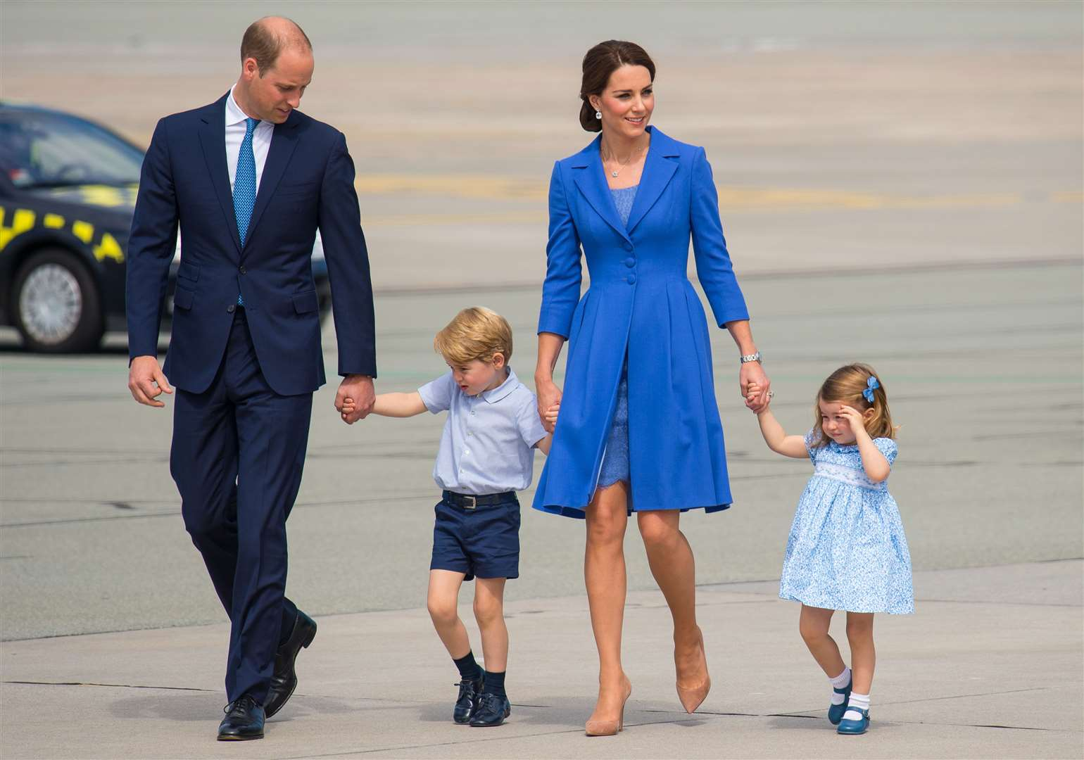 The Duke and Duchess of Cambridge, Prince George and Princess Charlotte at the airport ahead of a royal tour