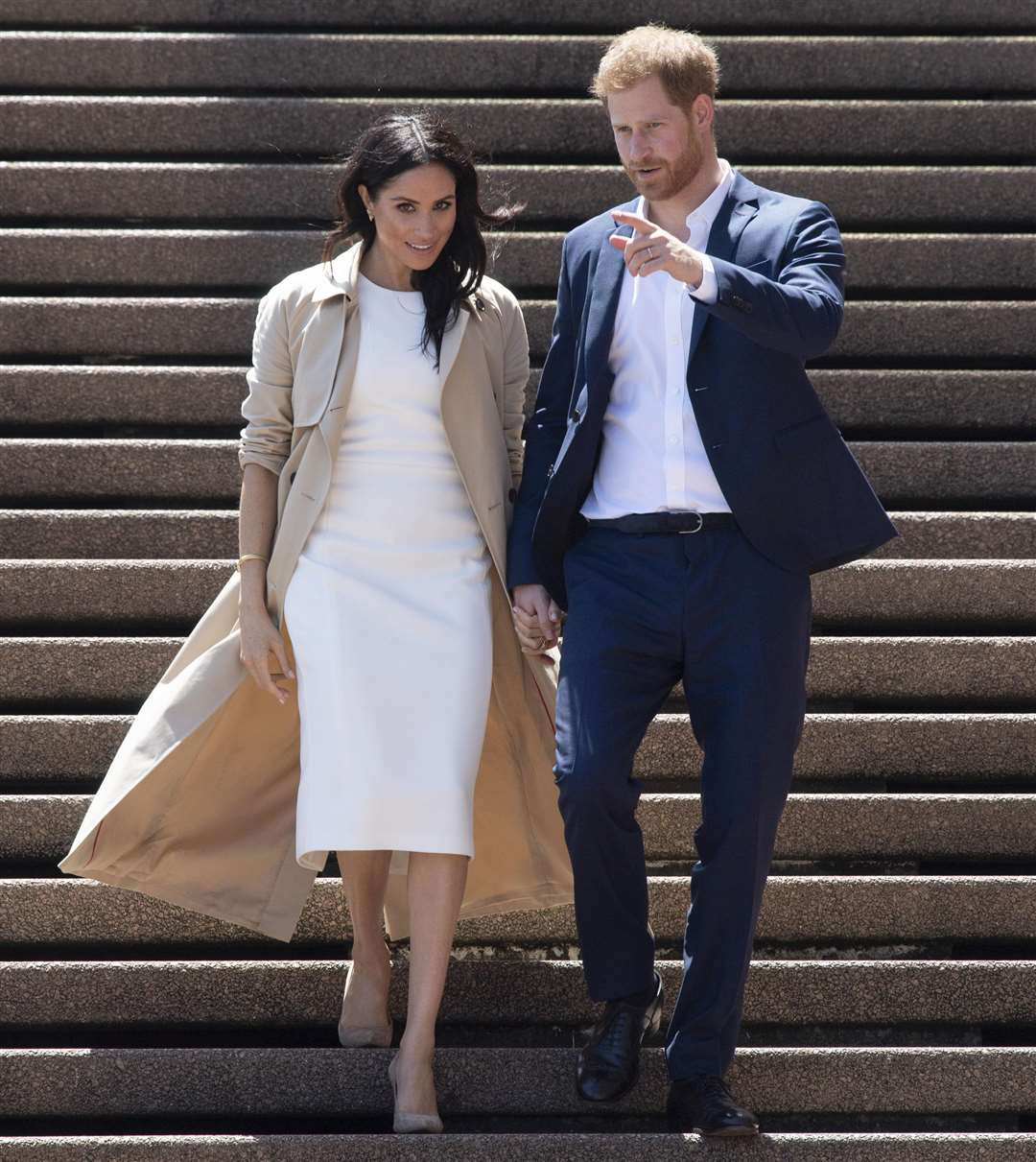 The Duke and Duchess of Sussex arrive for a walkabout outside the Sydney Opera House on the first day of their visit to Australia