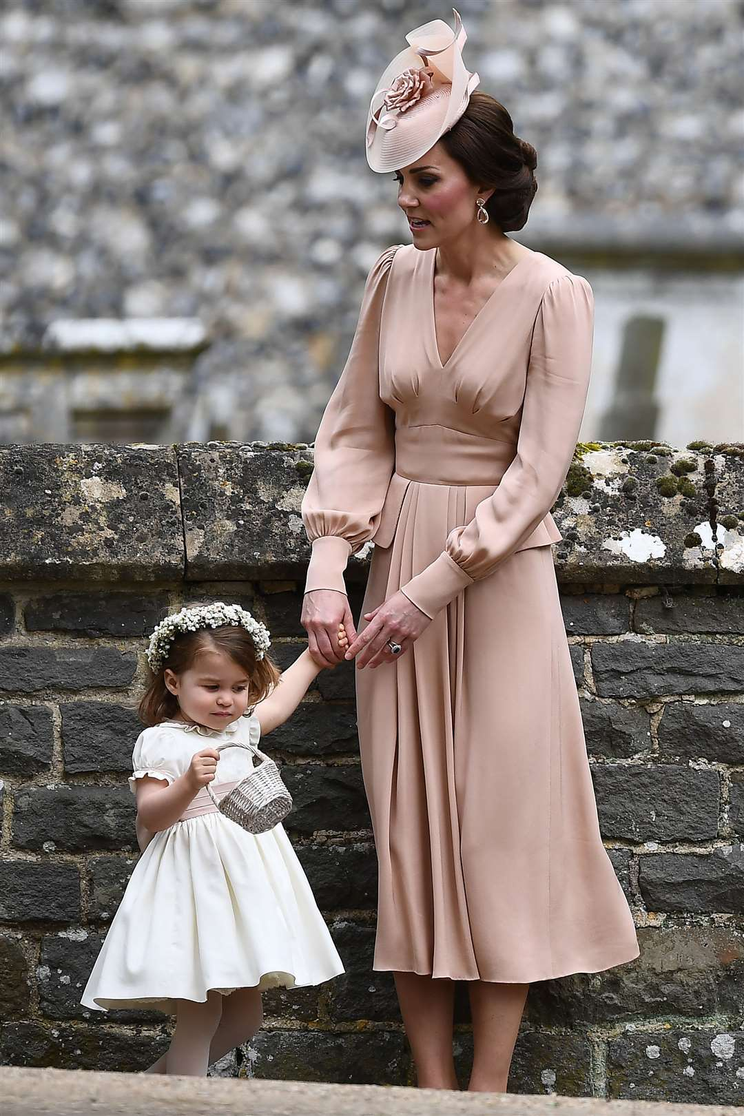 The Duchess of Cambridge with her daughter Princess Charlotte at the wedding of Pippa Middleton and James Matthews